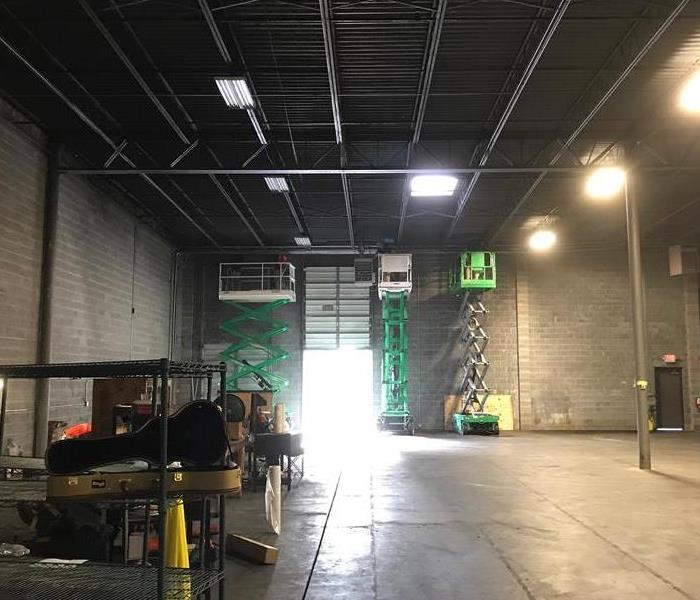 What is the best way to get rid of smoke and soot in a warehouse? After