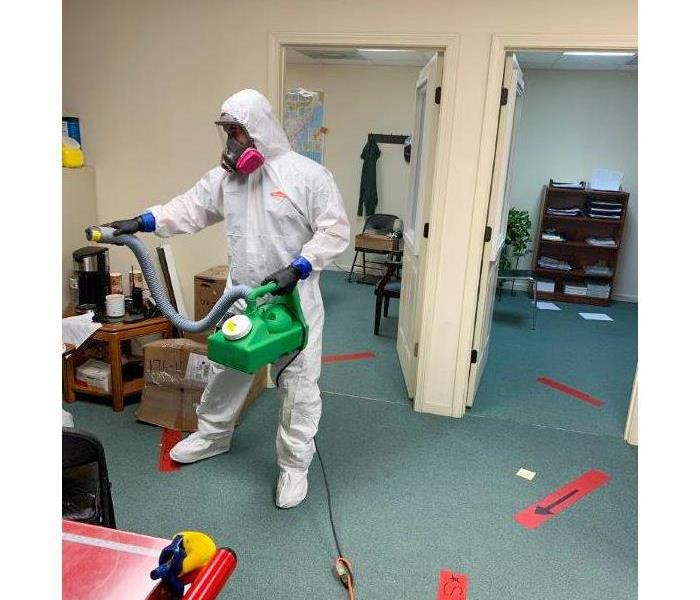 SERVPRO technician fogging and office space