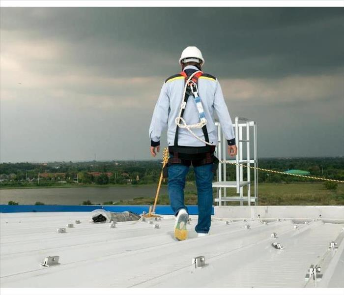 Construction engineer wear safety uniform inspection metal roofing work for roof industrial concept with copy space