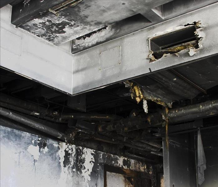 Inside of a building burned, ceiling has soot damage