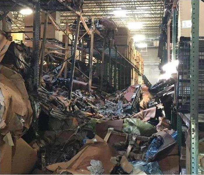 Contents and shelves damaged by fire in an Acworth, GA facility